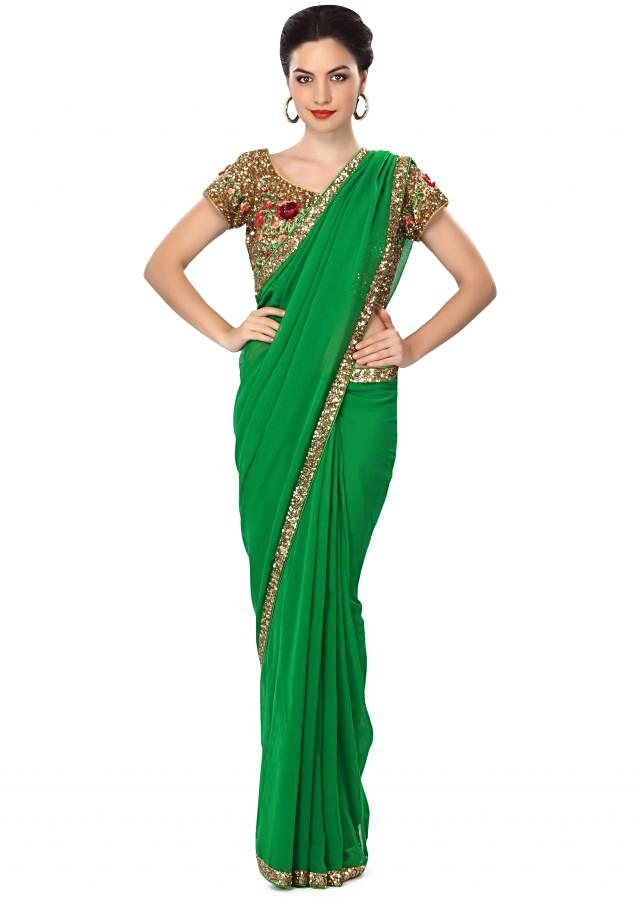 Majestic green saree embellished in sequin work only on Kalki