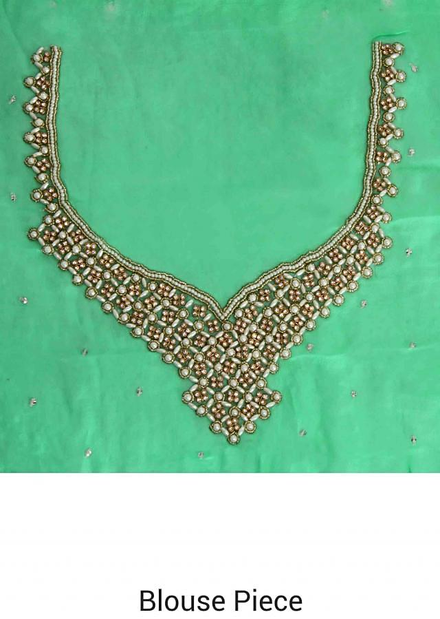 Green saree embellished in thread with embroidered border only on Kalki