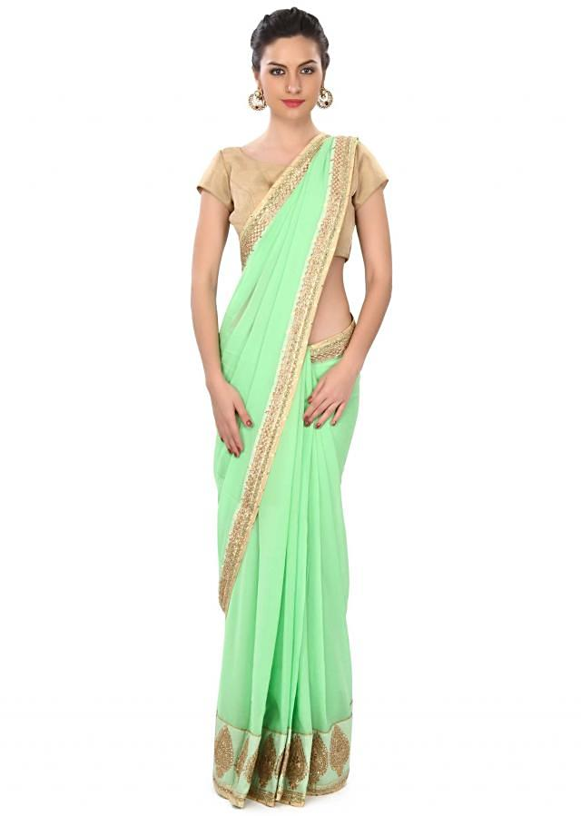 Opal green saree enhanced in zari and kundan embroidery only on Kalki