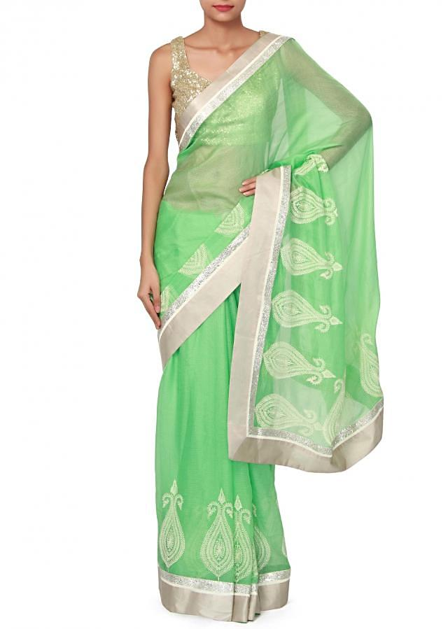 Green saree enhanced in thread embroidered butti only on Kalki