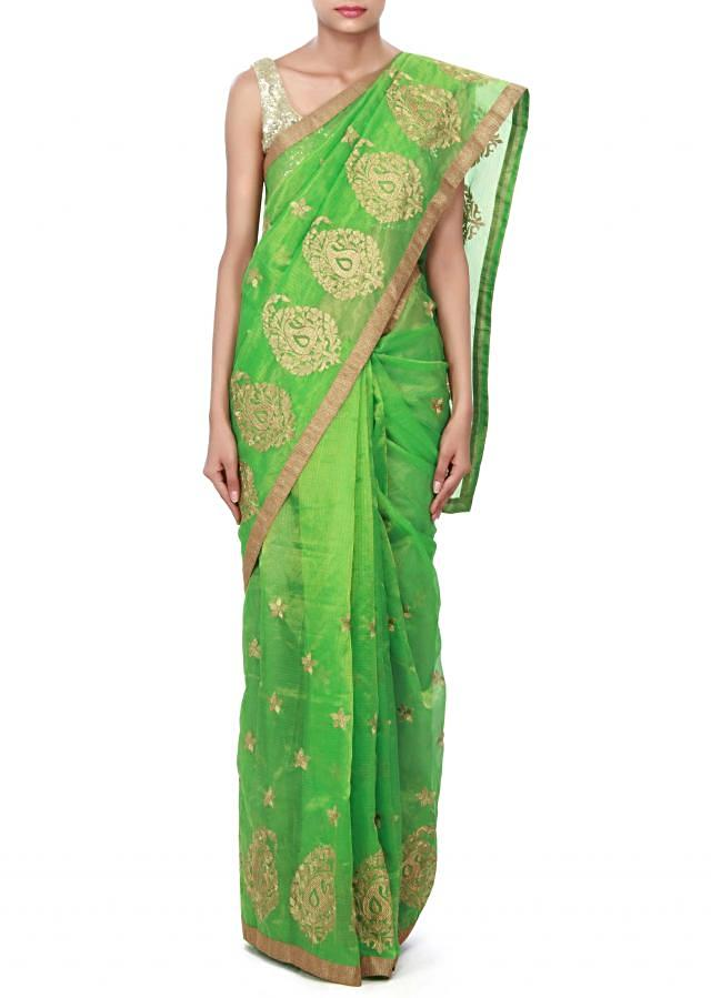 Green saree enhanced in zari weave embroidery only on Kalki