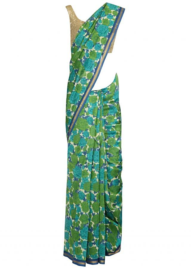 Green saree features with floral motif print all over only on Kalki