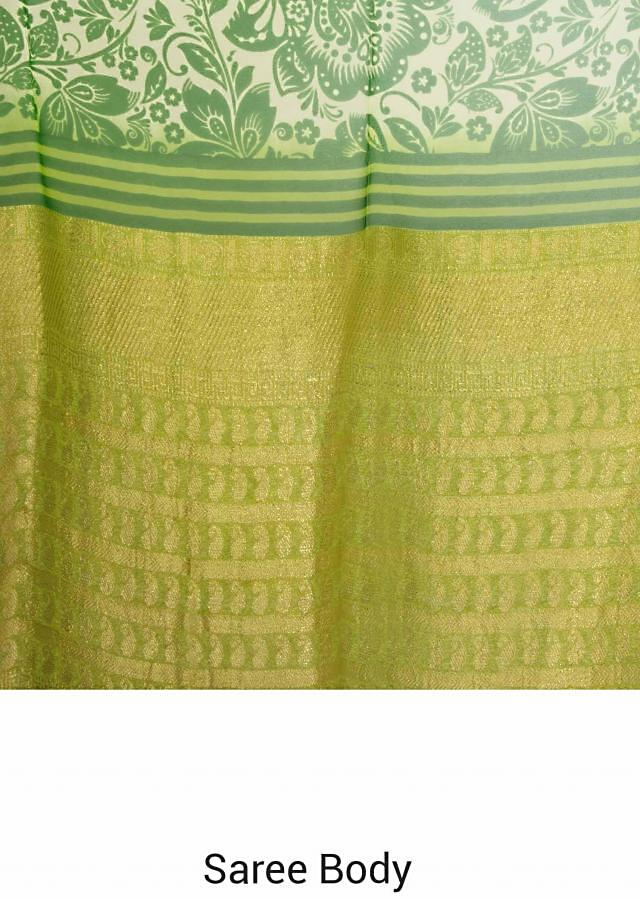 Green saree in floral print and weaved border only on Kalki