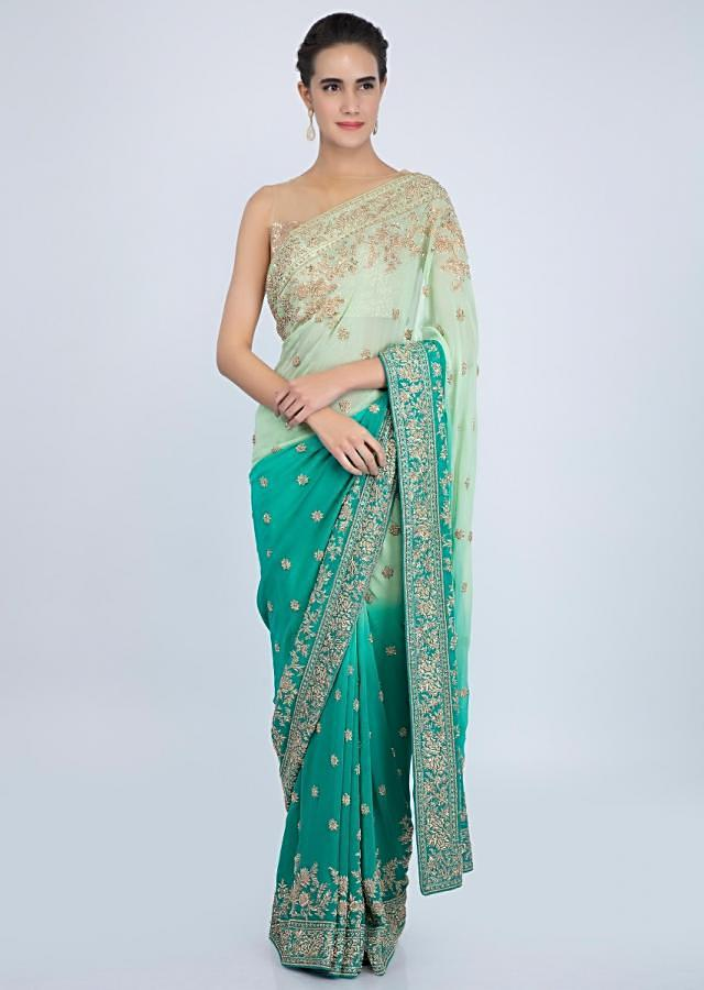 Green shaded georgette saree with floral embroidered butti and border only on kalki