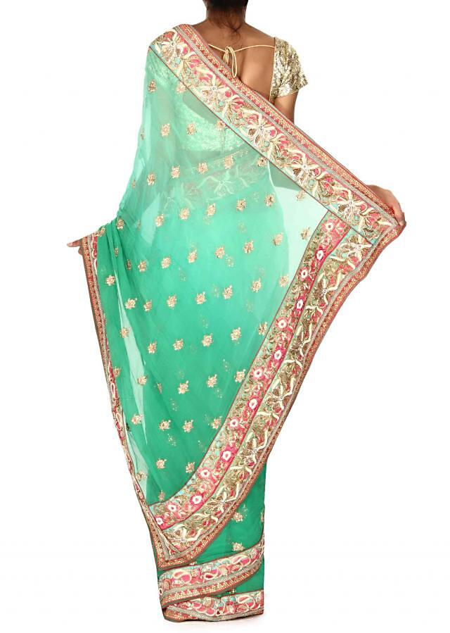 Dynasty green shaded saree in embroidered butti and border only on Kalki