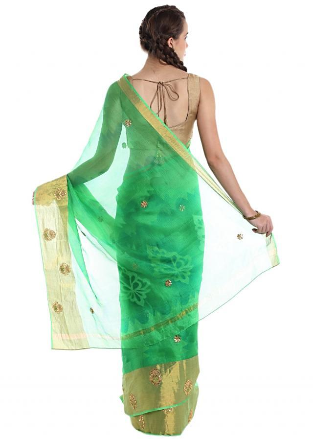 Green silk saree featuring gotta patch work  only on Kalki