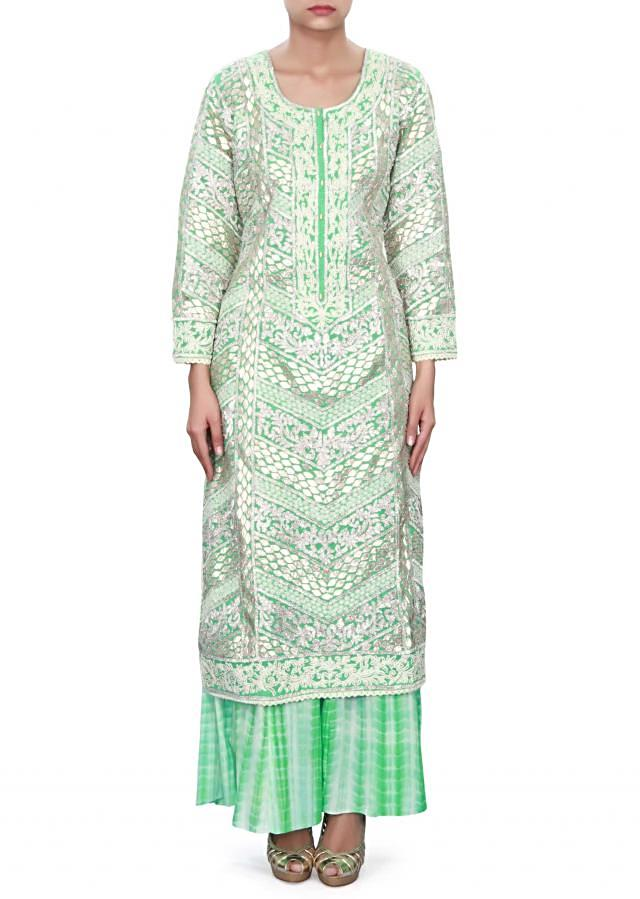 Green straight suit adorn in gotta patti embroidery only on Kalki