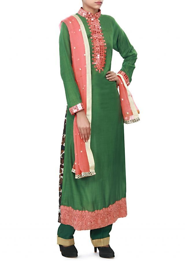 Green straight suit enhanced in mirror and resham embroidery only on Kalki