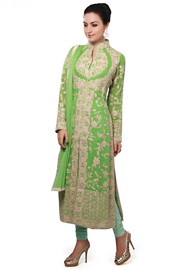 Green straight suit enhanced in thread embroidery all over only on Kalki