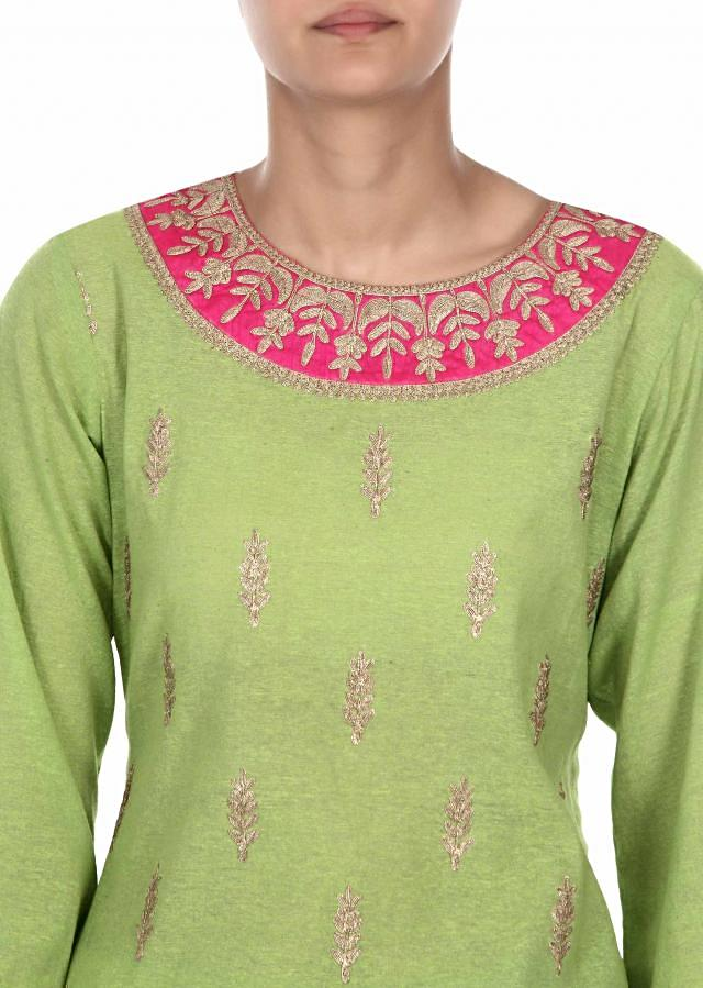 Green suit adorn in zari embroidered butti only on Kalki