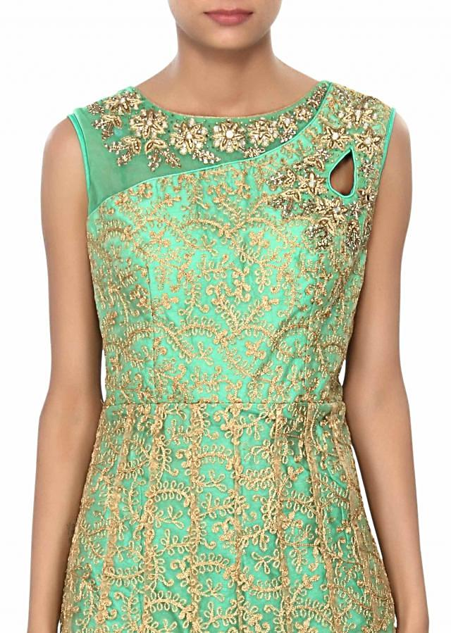 Green suit embellished in zari and kundan embroidery only on Kalki