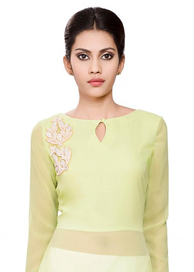 Green tunic with pink border and moti embroidery