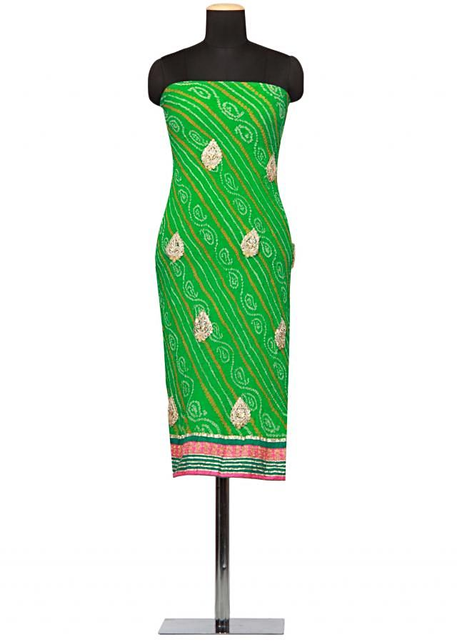 Green unstitched bandhani suit with gotta patti work