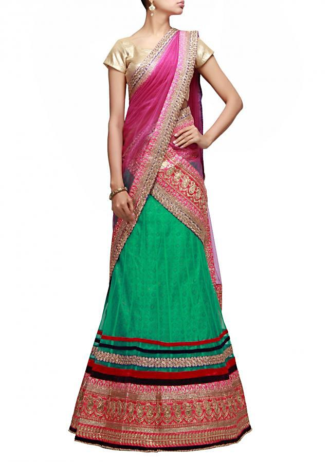 Green unstitched lehenga highlighted in lurex cut work