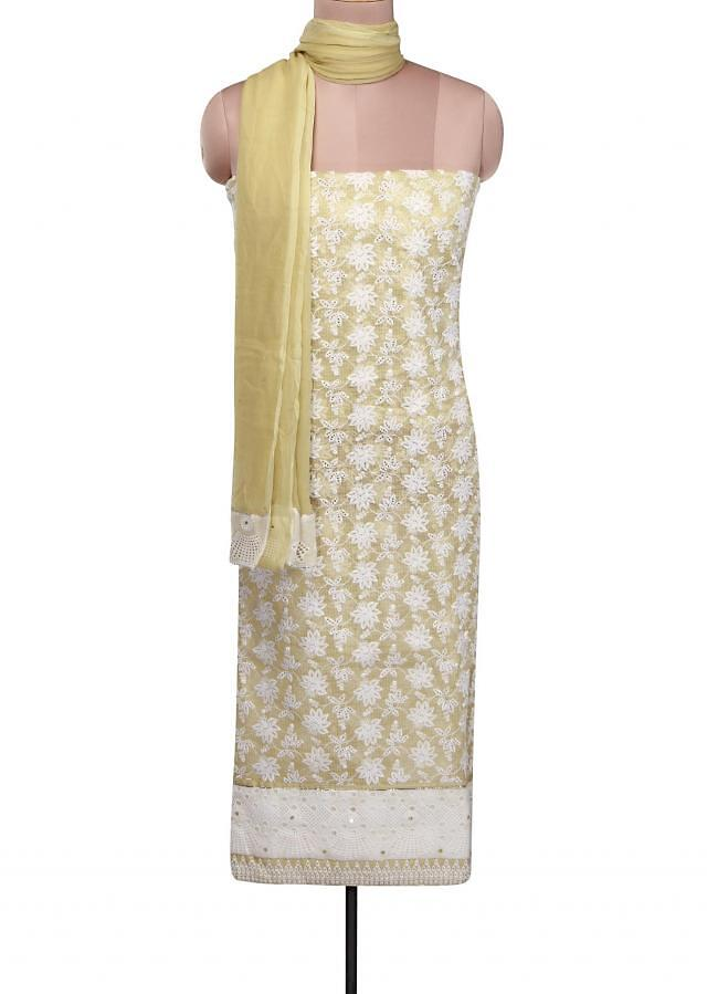 Green unstitched suit adorn in cut work thread embroidery only on Kalki