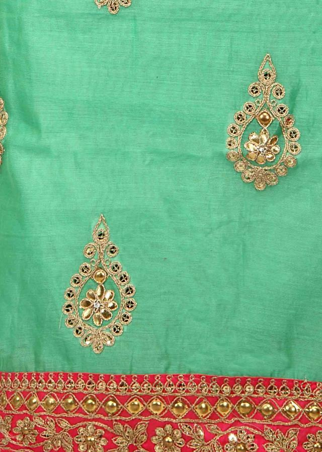 Green unstitched suit adorn in gotta patch emroidery butti only on Kalki