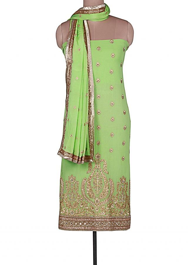 Green unstitched suit adorn in kundan and sequin embroidery only on Kalki
