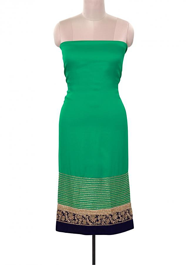 Green unstitched suit adorn in kundan and zardosi embroidery only on Kalki