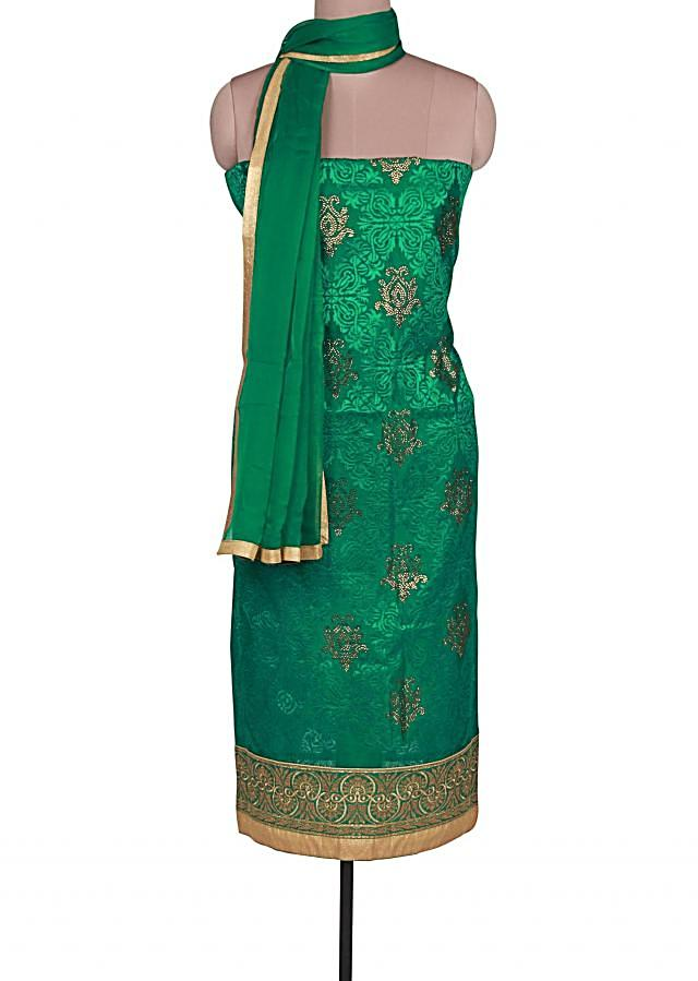 Green unstitched suit adorn in resham and zari embroidery only on Kalki