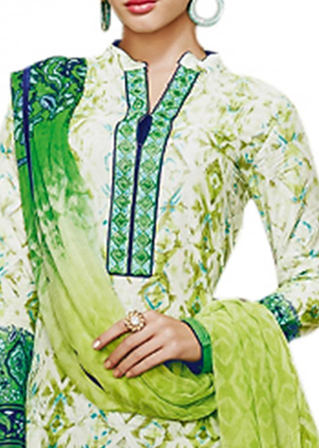 Green unstitched suit adorn in resham embroidery