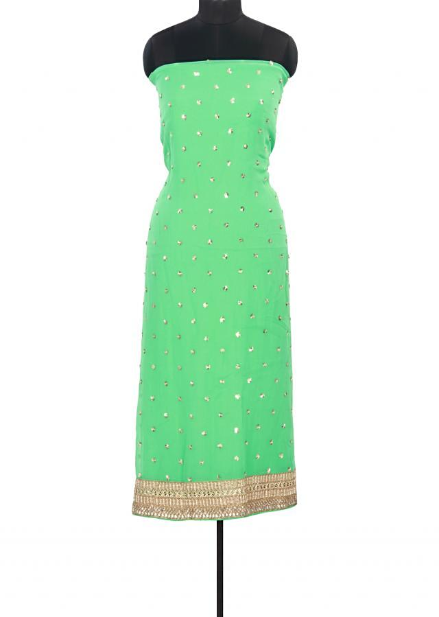 Green unstitched suit adorn in sequin work only on Kalki