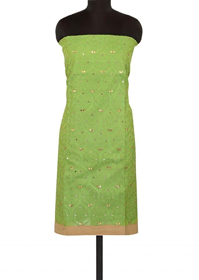 Green unstitched suit adorn in thread embroidery only on Kalki
