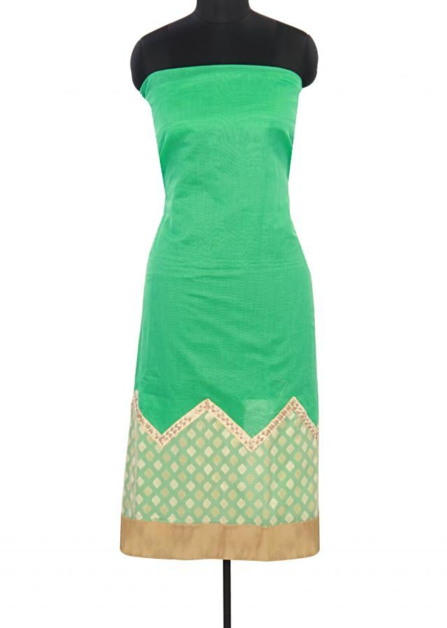 Green unstitched suit adorn in weave embroidery only on Kalki