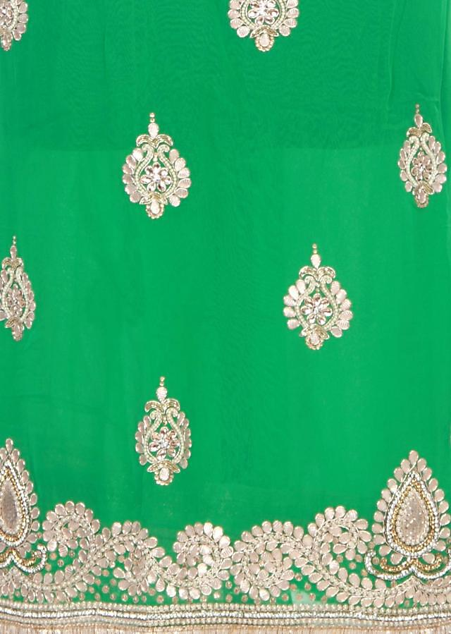 Green unstitched suit embellished in gotta patch work butti only on Kalki