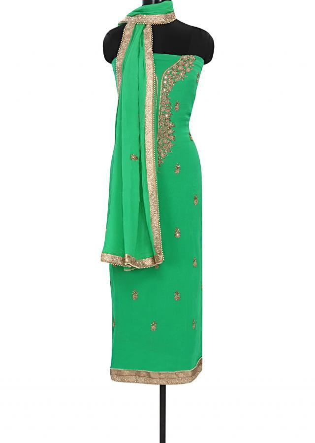 Green unstitched suit embellished in mirror and French knot embroidery only on Kalki