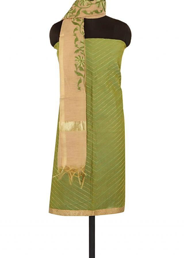 Green unstitched suit embellished in resham and zari only on Kalki