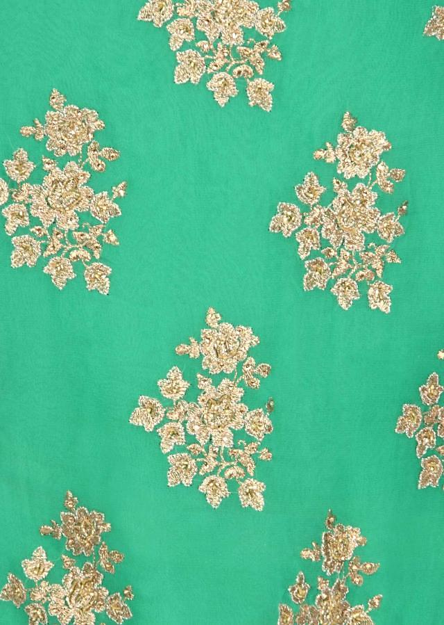 Green unstitched suit embellished in zari embroidery only on Kalki