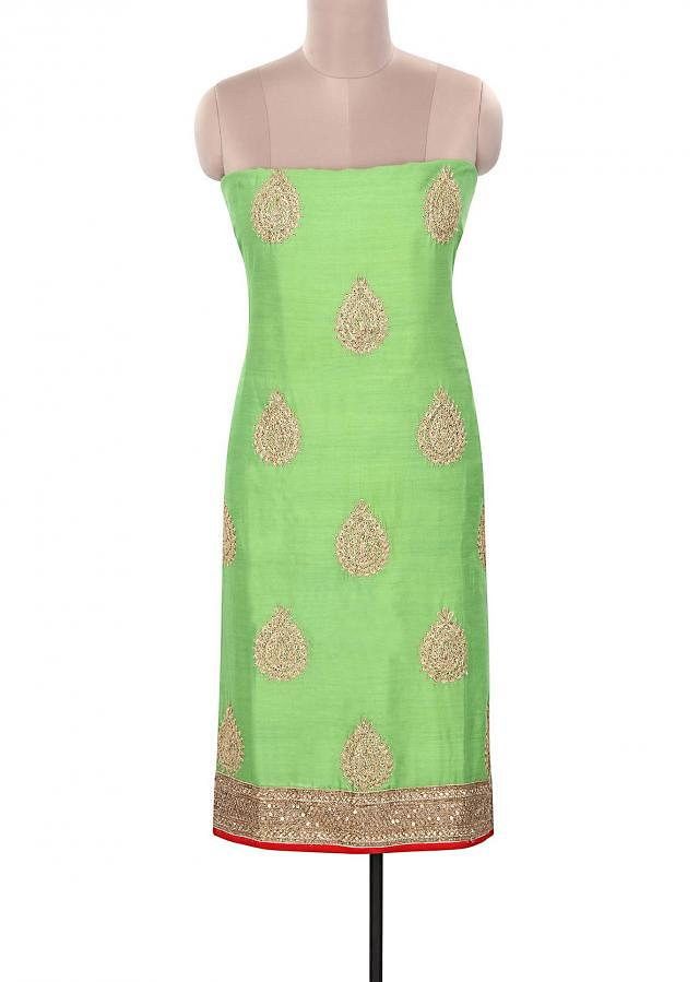 Green unstitched suit embellished in zari only on Kalki