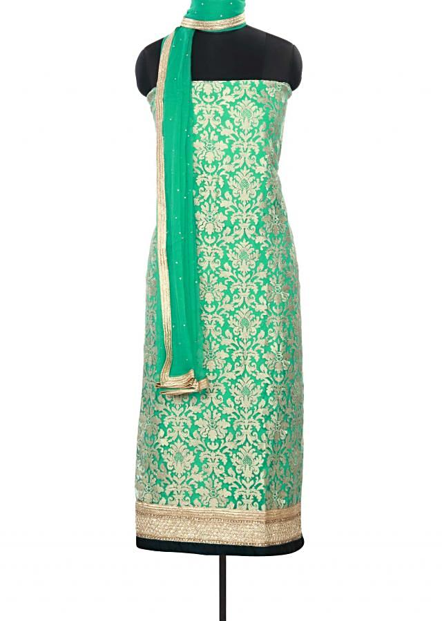 Green unstitched suit featuring in embellished net only on Kalki