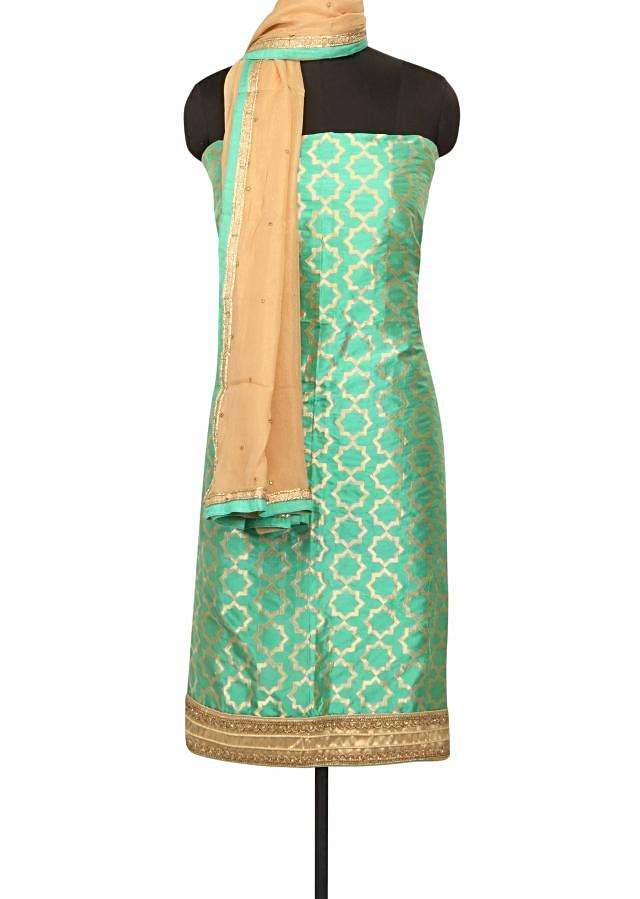 Green unstitched suit in embroidered hem line only on Kalki