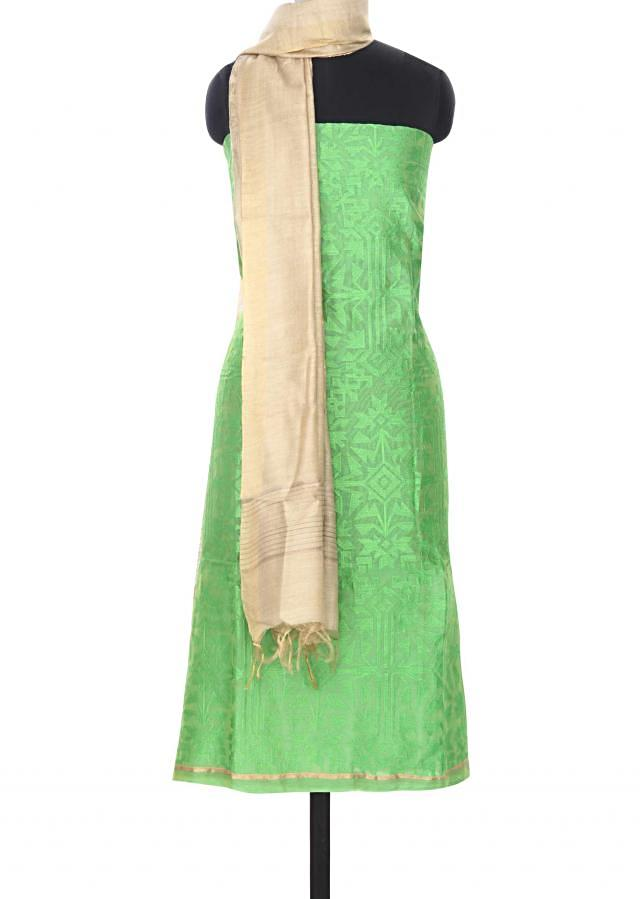 Green unstitched suit in geometric motif embroidery only on Kalki