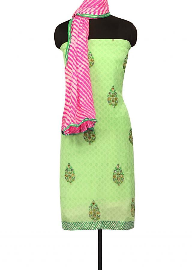 Green unstitched suit in pritned butti only on Kalki
