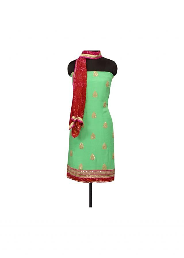 Green unstithced suit adorn in zari and sequin butti only on Kalki