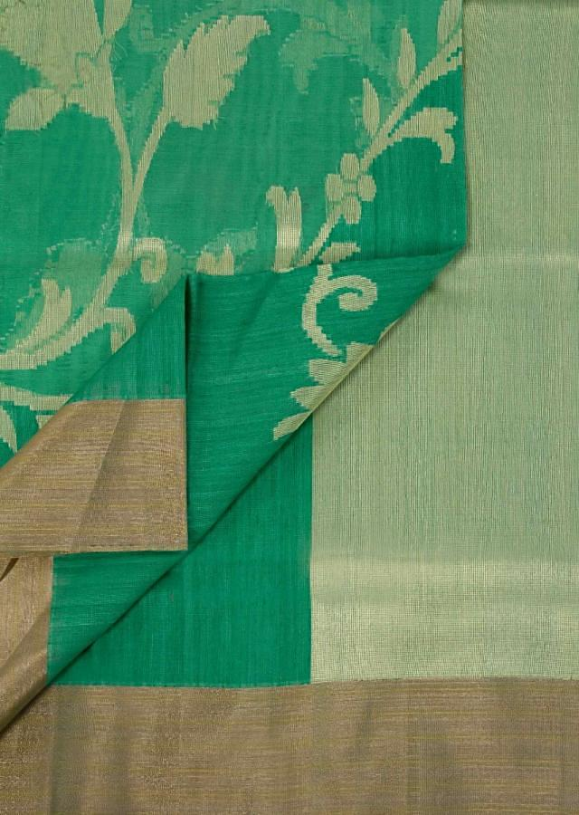 Green weaved saree in organza and raw silk fabric only on Kalki
