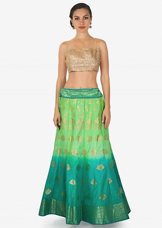 Green and turq shaded lehenga in silk enhanced in weave embroidery only on Kalki