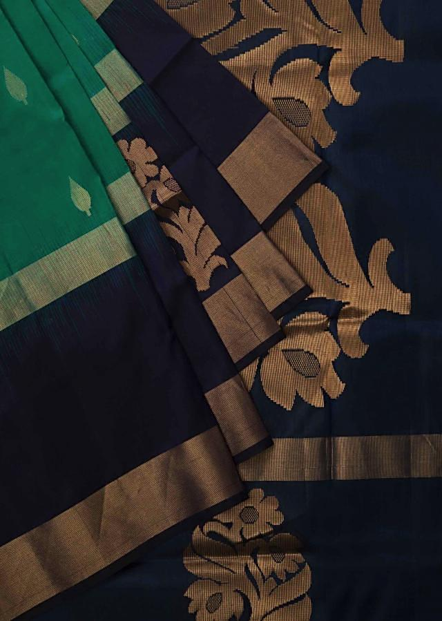 Green and navy blue saree in silk beautified in weaved embroidery only on Kalki