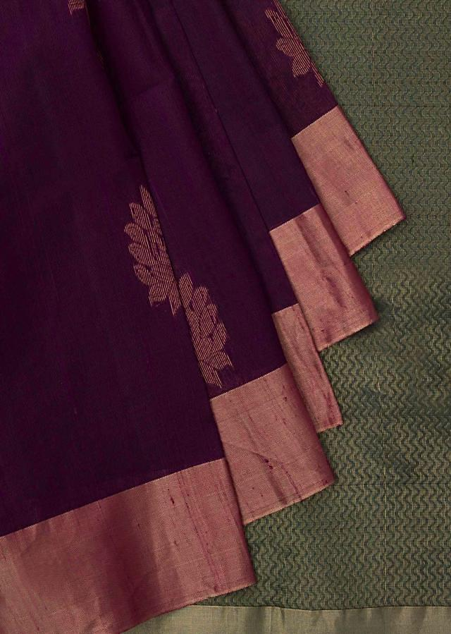 Green and rani pink saree in silk beautified in weaved embroidery only on Kalki