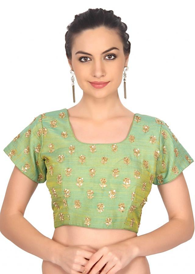 Green blouse adorn in sequin embroidery only on Kalki