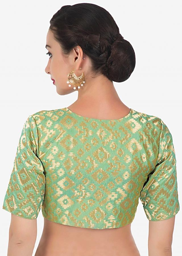 Green blouse in brocade silk with fancy potli buttons only on Kalki