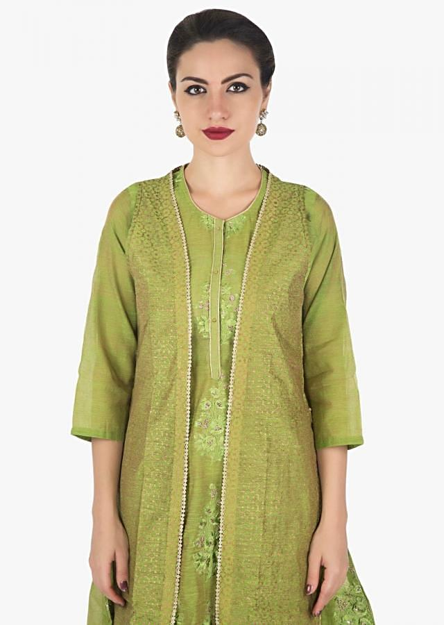Green kurti in Tussar silk with fancy hem line in resham and zari butti only on Kalki