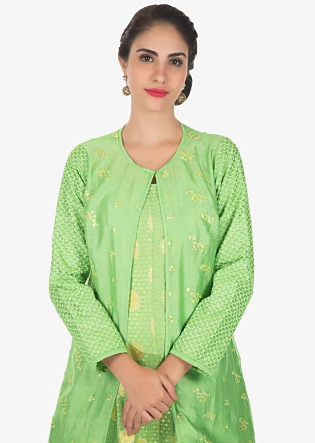 Green long anarkali dress in brocade silk with sequin embroidered jacket only on Kalki