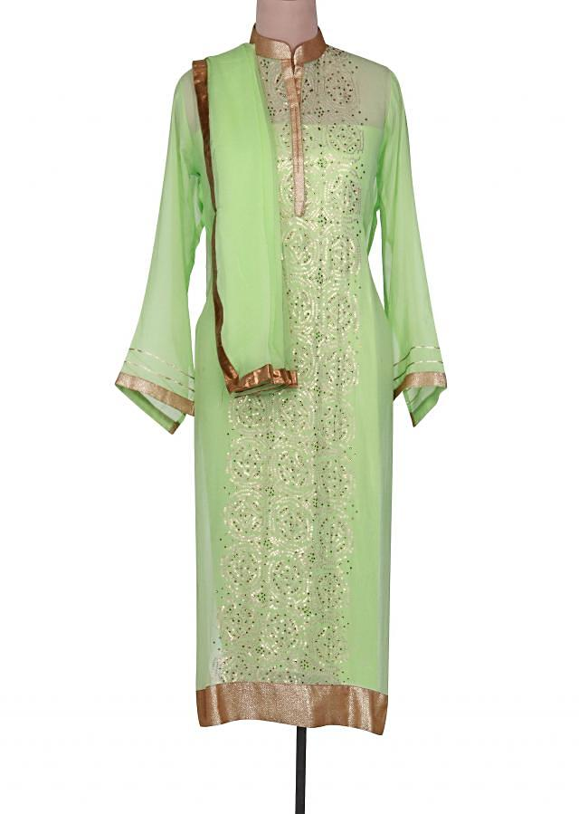 Green semi stitched suit embellished in sequin only on Kalki