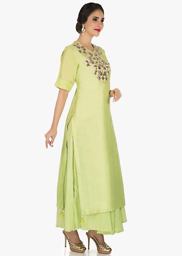 Green suit in silk embellished thread and cut dana embroidery work only on Kalki