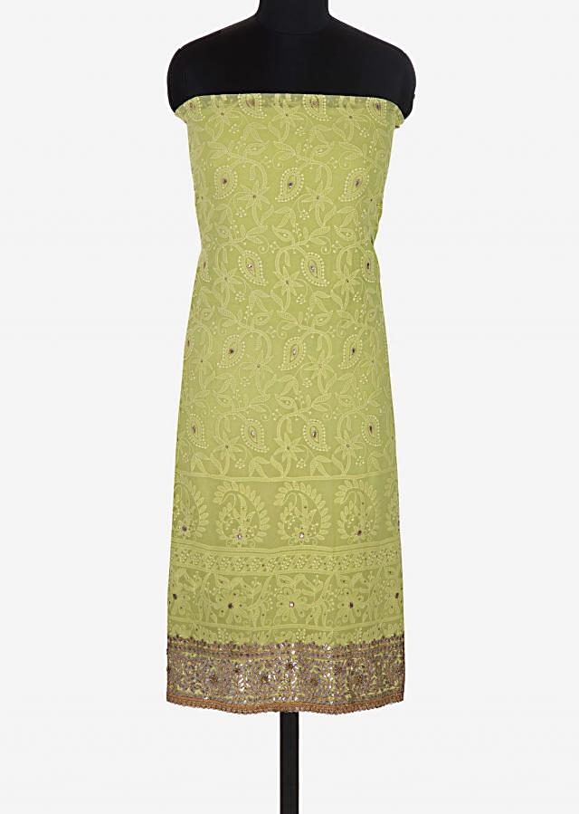 Green unstitched suit in georgette enhanced in paisley motifs only on Kalki
