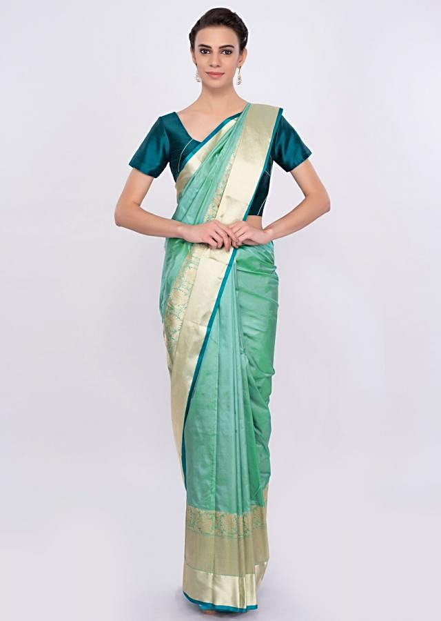 Greenish blue chanderi silk saree with brocade border only on Kalki
