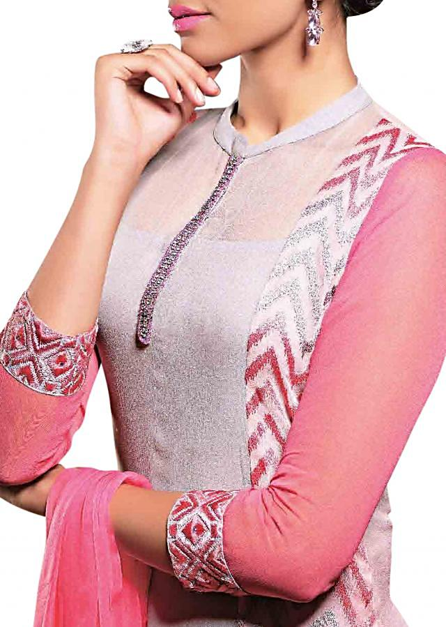 Grey and pink georgette semi-stitched suit embellished in resham